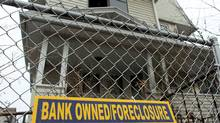 A foreclosure sign hangs in front of a Bridgeport, Conn., home on March 12, 2010. (Spencer Platt/Getty Images)