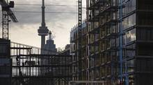 Construction workers work on a condominium development in Toronto. (MARK BLINCH/REUTERS)