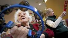 Vincenza Tropiano who is a resident at Villa Carital a long term care facility in Vancouver shakes a tambourine during a music program March 7, 2011. (John Lehmann/The Globe and Mail/John Lehmann/The Globe and Mail)