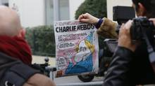 The front page of Charlie Hebdo, shown near the magazine's Paris office on Jan. 7, 2015, shows a caricature of French author Michel Houellebecq. (JACKY NAEGELEN/REUTERS)