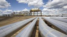 Sunshine Oilsands Ltd., largely backed by state-owned Chinese enterprises and Asian retail investors, faces 71 lawsuits seeking a total of $94-million for unpaid bills. (Dave Olecko)
