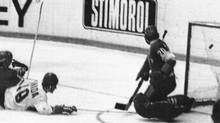 Canada's Paul Henderson, centre, scores past Soviet Union goalie Vladislav Tretiak, right, with only 2:06 minutes of play left in the Canada-USSR game in Moscow, Sept. 26, 1972. Two days later Henderson scored the series-clinching goal. (The Canadian Press/AP)