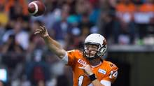 The B.C. Lions re-signed veteran quarterback Travis Lulay on Monday, a day before he was eligible for free agency. (DARRYL DYCK/THE CANADIAN PRESS)