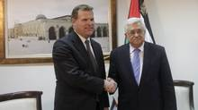 Palestinian President Mahmoud Abbas, right, and Canadian Foreign Minister John Baird, shake hands during a meeting in the West Bank city of Ramallah, Monday, Jan. 30, 2012. (Nasser Shiyoukhi/Nasser Shiyoukhi/AP)