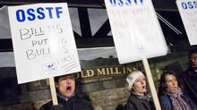 Demonstrators in support of the Ontario Secondary School teachers Federation and against Bill 115 picket outside of The Old Mill Inn and Spa in Toronto on Jan. 8. (Tim Fraser/The Globe and Mail)
