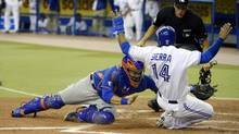 Toronto Blue Jays Moises Sierra (14) is tagged out by New York Mets catcher Travis d'Arnaud (15) in the third inning at Olympic Stadium. (Eric Bolte/USA Today Sports)