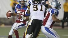 Montreal Alouettes quarterback Anthony Calvillo (13) throws against Hamilton Tiger-Cats during the first half of their CFL football game in Montreal, August 23, 2012. (CHRISTINNE MUSCHI/REUTERS)