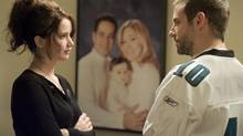 """Jennifer Lawrence and Bradley Cooper in a scene from """"Silver Linings Playbook"""""""