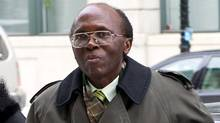 Leon Mugesera, accused of helping incite the Rwandan genocide, arrives at Federal Court Monday, January 9, 2012 in Montreal to seek a judicial review and a delay of his expulsion from Canada. (Paul Chiasson/The Canadian Press)