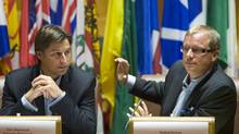 New Brunswick Premier Shawn Graham, left, and Saskatchewan Premier Brad Wall attend a meeting of the Council of the Federation in Regina on Wednesday.