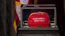 "A ""Make America Great Again"" hat sits in a case on the stage in the grand ballroom of the Hilton Midtown hotel. (Andrew Harrer/Bloomberg)"