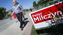 Liberal candidate Peter Milczyn knocks on doors with campaign workers in Etobicoke, Ontario Thursday, July 25, 2013. Milczyn is competing with Deputy Mayor Doug Holyday in an Etobicoke by-election. Polls opened on August 1, 2013. (Kevin Van Paassen/The Globe and Mail)