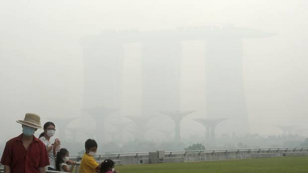 Singapore urged people to remain indoors amid unprecedented levels of air pollution Thursday as a smoky haze wrought by forest fires in neighbouring Indonesia worsened dramatically. (Joseph Nair/AP)