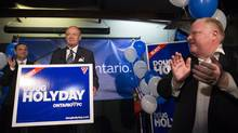 Doug Holyday (centre) the newly elected MPP for the Progressive Conservatives for the Etobicoke-Lakeshore riding is applauded by Toronto Mayor Rob Ford (right) and PC Leader Tim Hudak (left) after winning the Ontario by-election on Thursday August 1, 2013. (CHRIS YOUNG FOR THE GLOBE AND MAIL)