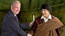 Former Canadian prime minister Paul Martin meets with Moammar Gadhafi in Tripoli in 2004. (Yousef al-Ageli/Reuters)