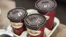 Coffee cups sit at a Tim Hortons in Oakville, Ont. on September 16, 2013. (Chris Young/THE CANADIAN PRESS)