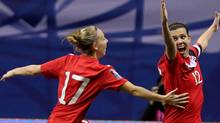 Canada's Christine Sinclair, right, celebrates her goal against Mexico with teammate Brittany Timko during the second half of CONCACAF women's Olympic qualifying soccer at B.C. Place in Vancouver, B.C., Friday, Jan. 27, 2012. THE CANADIAN PRESS/Jonathan Hayward (Jonathan Hayward/CP)