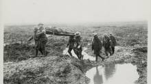 Wounded Canadians on their way to an aid post during the Battle of Passchendaele in November, 1917: Despite a much smaller population, the country lost almost as many soldiers as the United States. (George Metcalf Archival Collection CWM 19930013-464 O.2201 © Canadian War Museum)