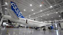 Bombardier's CS300 aircraft sits in a hangar prior to its test flight in Mirabel, Que., on Feb. 27, 2015. (Christinne Muschi/Reuters)