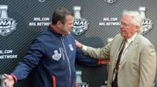 Jun 3, 2014; Los Angeles, CA, USA; New York Rangers coach Alain Vigneault (left) greets general manager Glen Sather during media day before game one of the 2014 Stanley Cup Final against the Los Angeles Kings at Staples Center. (Kirby Lee/USA Today Sports)