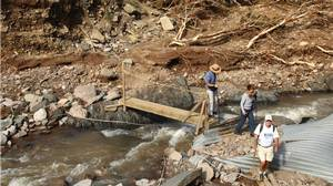 Planks span Meat Cove Brook, where a bridge was knocked out in the torrent.