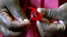 A Kenyan woman prepares ribbons for World Aids Day. (Antony Njuguna/REUTERS)