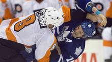 Philadelphia Flyers defenceman Nicklas Grossmann and Toronto Maple Leafs David Clarkson tussle during NHL pre-season action in Toronto (Frank Gunn/The Canadian Press)