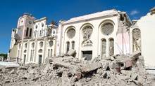 The Cathedral of Port-au-Prince remains standing, yet badly damaged following a major quake January 14, 2010 in Port-au-Prince, Haiti. (Frederic Dupoux/Frederic Dupoux/Getty Images)