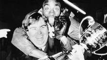 "Toronto Argonauts Raghib ""Rocket"" Ismail jumps on the back of team co-owner and actor John Candy while he was holding the Grey Cup during victory celebrations back in Toronto after the game. The Toronto Argonauts had defeated the Calgary Stampeders 36-21 in the annual fall classic held at Winnipeg Stadium Nov. 24, 1991. Chris Schwarz / REUTERS (Chris Schwarz/REUTERS)"
