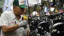 Employees at Honda's Alliston plant work assembling engines, in this file photo. (Deborah Baic/The Globe and Mail)
