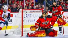 Calgary Flames goalie Jonas Hiller (1) guards his net as Florida Panthers centre Corban Knight (53) tries to score during the first period at Scotiabank Saddledome in Calgary on Wednesday, Jan. 13, 2016. (Sergei Belski/USA Today Sports)