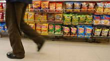 Several kinds of food products, including chips, are being sold in smaller sizes, experts say. (Lisa Poole/Associated Press/Lisa Poole/Associated Press)