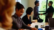 AA018409 (PhotoDisc Image #) - Businesspeople in a Meeting (Ryan McVay/�PHOTODISC)