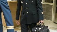 Warrant officer Andre Gagnon walks to testify at his court martial at the St-Malo Armoury Tuesday, August 12, 2014 in Quebec City. (Clément Allard/THE CANADIAN PRESS)