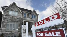 Mortgage insurance is mandatory in Canada for banks issuing mortgages to home buyers with down payments of less than 20 per cent. (Fred Lum/Fred Lum/ The Globe and Mail)