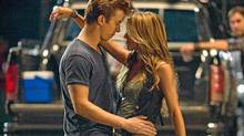 "Kenny Wormald and Julianne Hough dance it up in ""Footloose."" (K.C. Bailey)"