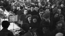 Shoppers crowd a Woolworths store during the Christmas rush of 1955. (Charles Hewitt/2004 Getty Images)