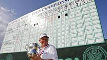 Colin Montgomerie poses with the Francis D. Ouimet Memorial Trophy (Sue Ogrocki/AP)