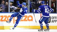 Toronto Maple Leafs forward Mitch Marner (16) celebrates his first career goal with forward Tyler Bozak (42 during the first period against Boston Bruins at Air Canada Centre in Toronto on Saturday, Oct. 15, 2016. (Dan Hamilton/USA Today Sports)