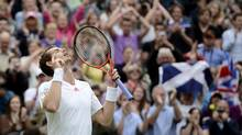 Andy Murray of Britain celebrates after defeating David Ferrer of Spain in their men's quarter-final tennis match at the Wimbledon tennis championships in London July 4, 2012. (DYLAN MARTINEZ/REUTERS)