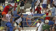 In this Saturday, June 11, 2016 file photo, Russian supporters attack an England fan at the end of the Euro 2016 Group B soccer match between England and Russia, at the Velodrome stadium in Marseille, France. A Russian lawmaker has proposed an unorthodox solution to the country's football hooliganism woes ahead of next year's World Cup, legalize it and turn it into a spectator sport. (Thanassis Stavrakis/AP)