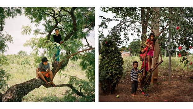 Left: Alisson Ortis and Nicole Samoiri Martin, both eight years old, play in a tree in their yard in Amambai. Nicole lost her father and brother to suicide. Right: Miguel Desilva, 4, Bruna Feliciano Desilva, 6, and Neto De Silva, 8, are shown in the village of Jiguarapiru on the Dourados reserve.