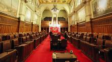 Workers clean the Senate chamber in Ottawa on Jan. 27, 2011. (FRED CHARTRAND/THE CANADIAN PRESS)