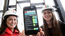 Lauren Hasegawa, left, and Mallorie Brodie, the founders of Bridgit, created a smartphone app that tracks construction defects for builders. Now they are wondering whether they should go for broke and create a similar app for consumers. (Glenn Lowson For The Globe and Mail)