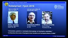 A overhead projector displays the photos of the winners of the Nobel Prize in physics, at the Royal Swedish Academy of Sciences, in Stockholm, Sweden, Tuesday, Oct. 4, 2016. David Thouless, Duncan Haldane and Michael Kosterlitz have won the Nobel physics prize. Nobel jury praises physics winners for 'discoveries of topological phase transitions and topological phases of matter'. (Anders Wiklund/AP)