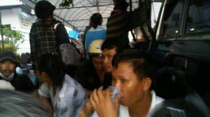 Thai protesters hide behind truck after a bullet whizzes through Wat Patum temple compound. Globe correspondent Mark MacKinnon sent these pictures from inside the compound.