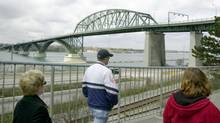 Pedestrians walk on a path in front of the international Peace Bridge in Buffalo, N.Y.,in this May 3, 2003, file photo. (DAVID DUPREY/AP)