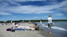 Beach goers enjoy a warm summer afternoon at Woodbine Beach in Toronto, Ontario Friday, July 26, 2013. (Kevin Van Paassen/The Globe and Mail)