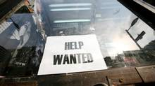 "A help wanted sign is posted in the window at ""World of Posters"" on Yonge St. (Charla Jones/The Globe and Mail)"