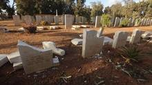 Gravestones are seen damaged by an Islamist group in protest at the burning of the Koran by U.S. soldiers in Afghanistan, in Benghazi Military Cemetery February 24, 2012. The cemetery, which is home to soldiers who died during the second world war, was built by the Commonwealth War Graves Commission. (© Esam Al-Fetori / Reuters/REUTERS)